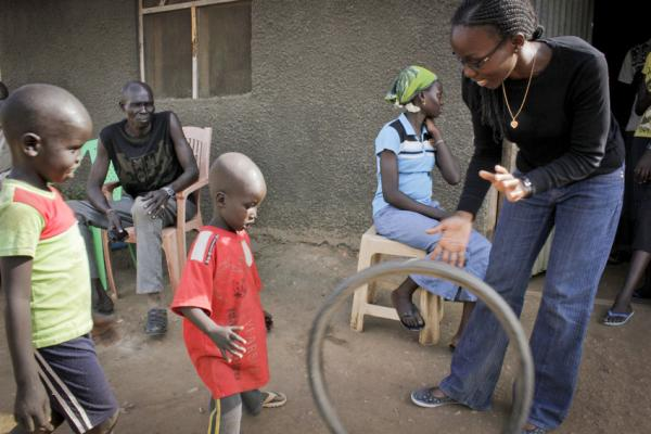 Child protection worker Yvonne plays with 3-year-old Ulu, who was separated from his family during fighting in South Sudan. We trace and reunite separated families. Jenn Warren/Save the Children