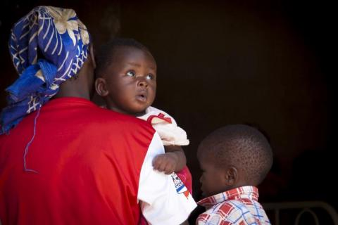 A mother waits to be seen at Mbres hospital, Central African Republic